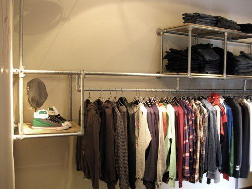 Shop fitting and garment displays wall mounted